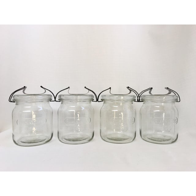 Rare to find a set of four vintage Ruhrglass fruit jars with original glass lids & aluminum clamp closures in such perfect...