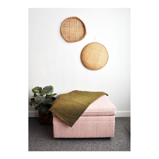 Lovely upholstered ottoman in a blush pink color. Versatile piece that can be used to rest your feet, as extra seating, or...