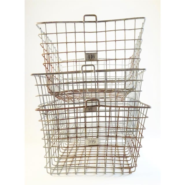 Set of three vintage primitive wire locker baskets. Unique labels are tagged in front. These rustic baskets are perfect...