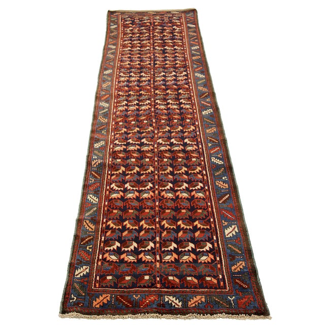 Persian runner rug handwoven from the finest sheep's wool. It's colored with all-natural vegetable dyes that are safe for...
