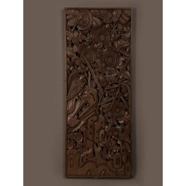 A handsome carved timber panel featuring a stylized landscape with birds and foliage from China c.1900.