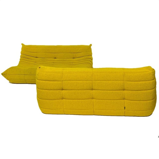 Rare color heavy weave yellow togo sofa designed by Michel Ducaroy for Ligne Roset. Very nice original condition. 3...