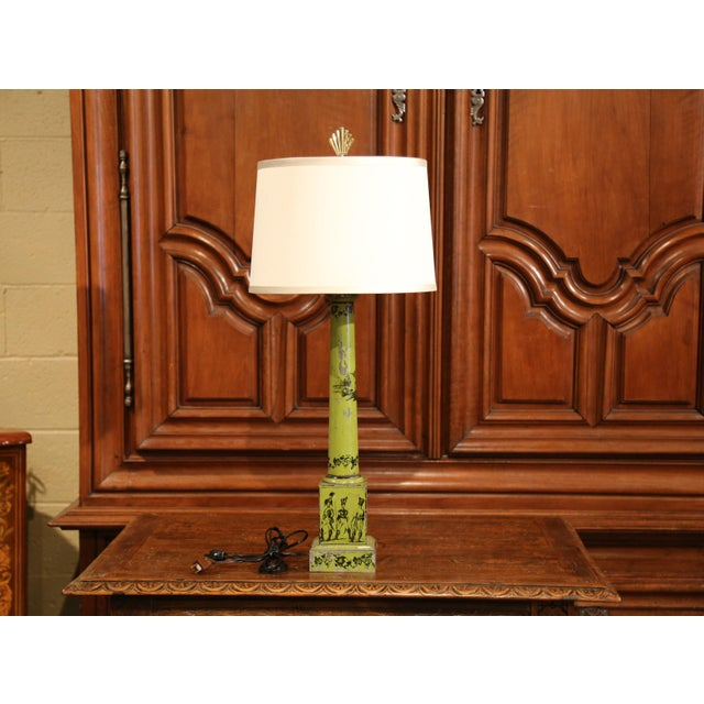 Elegant antique tole lamp from France; crafted circa 1840, the lamp with new wiring sits on a square base, and features...