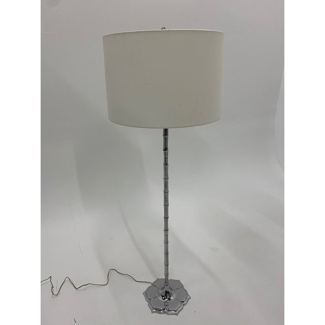 Elegant Mid-Century Modern chrome floor lamp with faux bamboo column and pretty lotus flower shaped base. Shade not included.