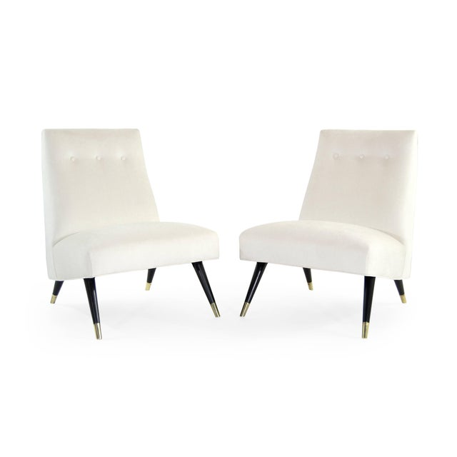 Pair of low profile lounge chairs by Karpen of California, circa 1950s. Newly upholstered in ivory cotton linen by Kravet....
