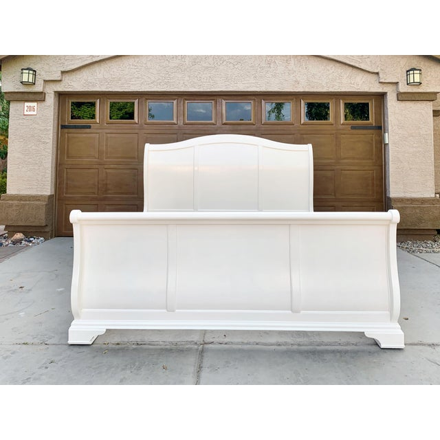 This is a beautiful traditional, king size, cherry sleigh bed, sprayed with oil based enamel linen white.
