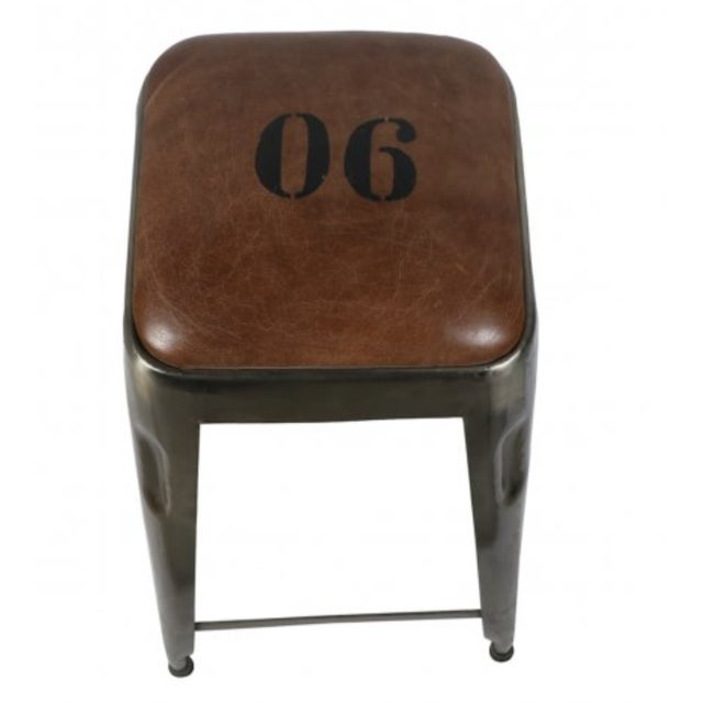 Line multiple Ironworks Counter Stools along a breakfast bar or high-top table. With a newly upholstered, leather seat...