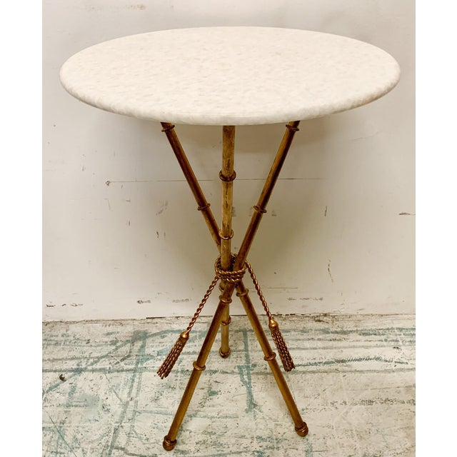 This is a 1970s gilt faux bamboo metal side table with white marble top. The top is attached, and it is in excellent...