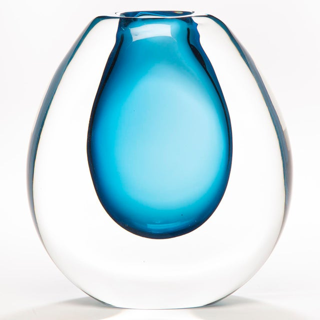 Handblown in Finland, this tall sommerso art glass vase has a heavy, clear cased glass outer layer and blue colored core....