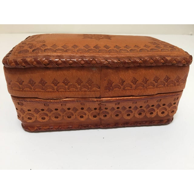 Hand tooled vintage leather box from Morocco camel color stamped with darker brown. The workmanship of this piece is very...