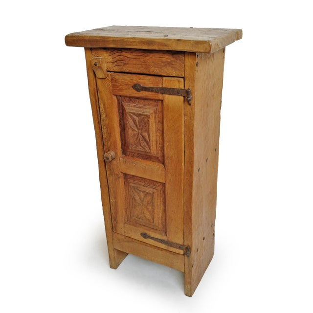 Vintage mesquite wood side cabinet with hand forged iron hardware. Hand carved design on door with one shelf inside....