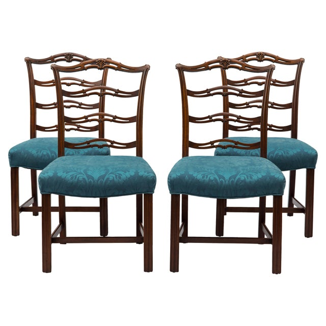 Exceptional set of four carved mahogany ladder or ribbon-back Chippendale-style side chairs, circa 1900. Each has three...