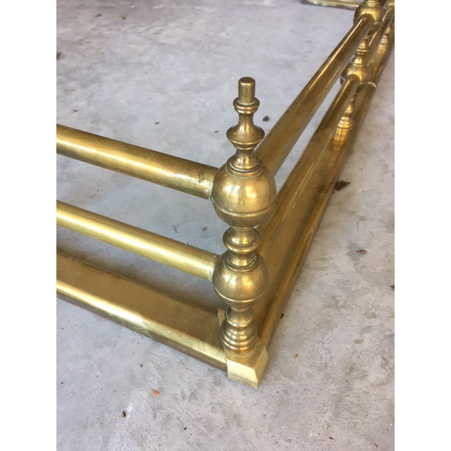 This very substantial brass fireplace fender was purchased in Atlanta Georgia 30+ years ago at an antique shop.  It is heavy and has great patina! ...