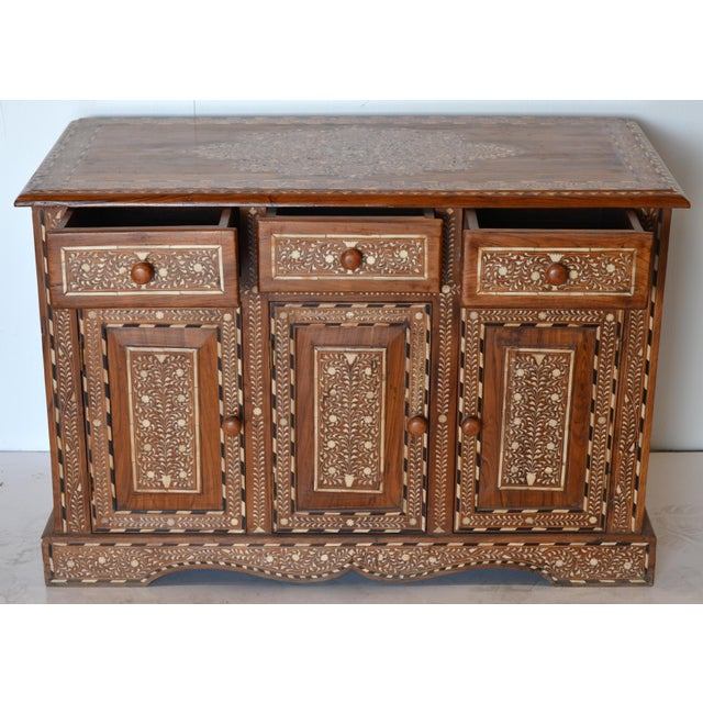 This inspired by a famous piece found in one of Morocco's most famous hotels. The inlay work is an extremely laborious,...