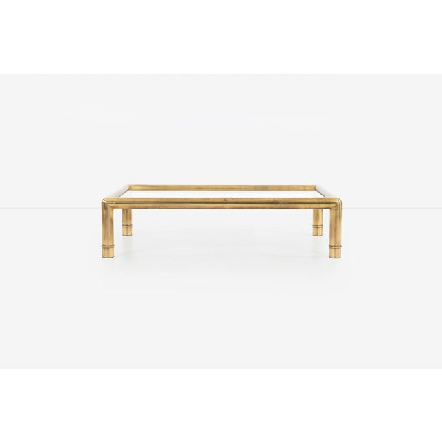 "Large scale tubular brass coffee table with 3/8"" glass. Patina throughout the coffee table."
