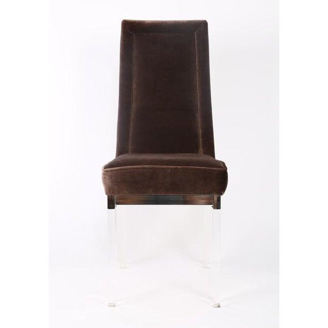 Set of four elegant 1970s dining chairs in gray velvet on chrome bases with lucite legs.