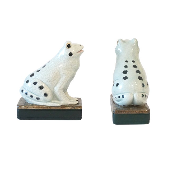 Charming hand painted garden frog figurines in a delicate shade of celadon featuring a crackle glaze, sponged on black...