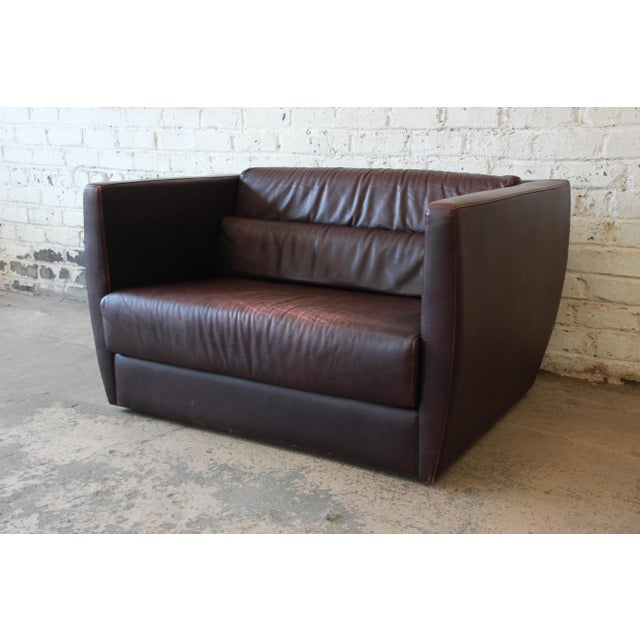 Offering an exceptional Bauhaus style leather love seat or oversized chair by Roche Bobois. The love seat features...