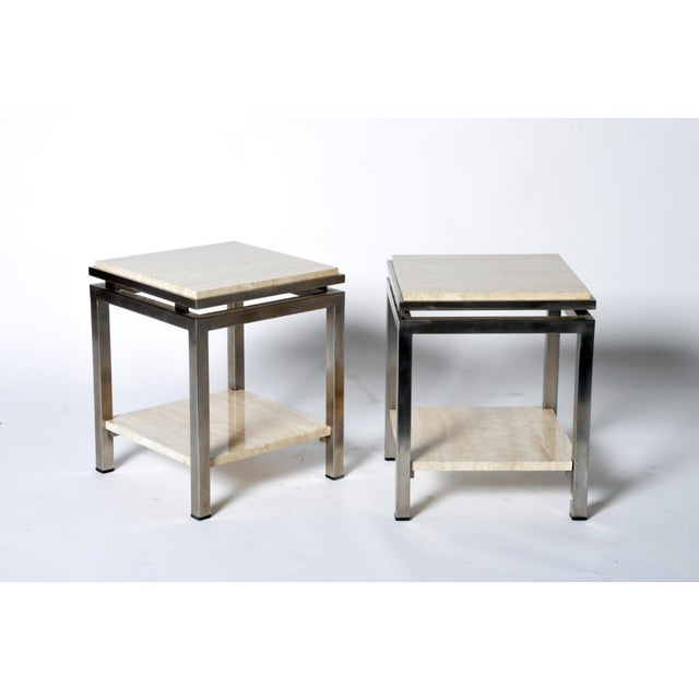 Pair of Two-Tier Travertine Side Tables in the Style of Guy Lefevre For Maison Jansen | 1970. These Mid-Century Modern...