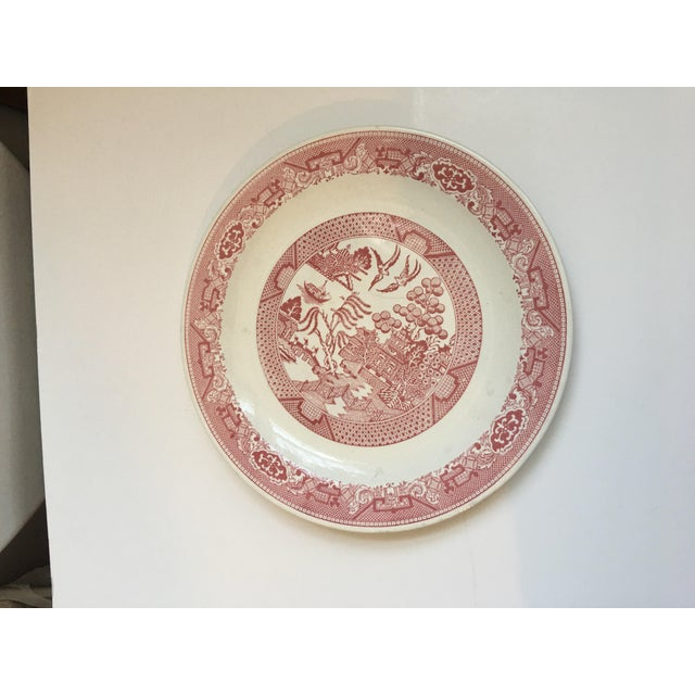 Vintage Willow Ware round porcelain serving plate in wonderful dusty rose and white tones. Seems to be in decent weather....