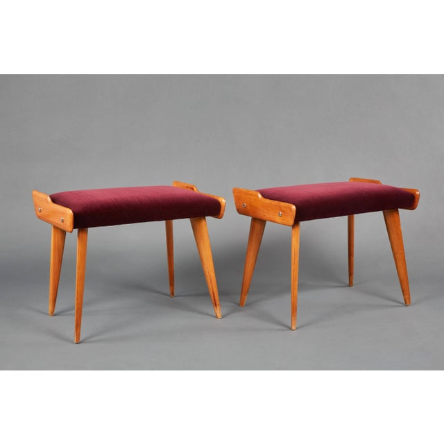 A unique pair of fruitwood stools in the style of Carlo de Carli. In wood and wine velvet with metal details.
