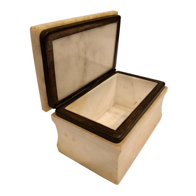 A 1940s Italian cream colored marble table top box with great style and a hinged lid.
