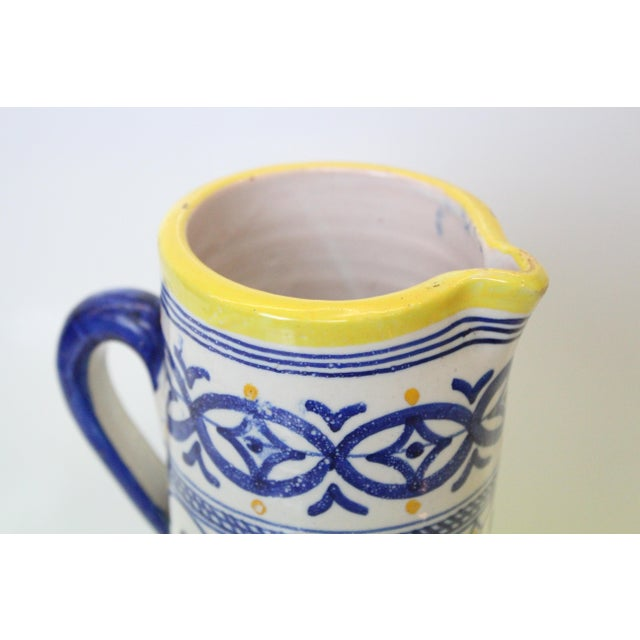 Yellow, white, and blue art nouveau Italian provincial jug with handle.