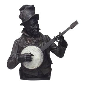 American Victorian style (late 19th Cent) metal bust of black banjo player wearing top hat with flowers on oval base (signed P. CALVI) For Sale