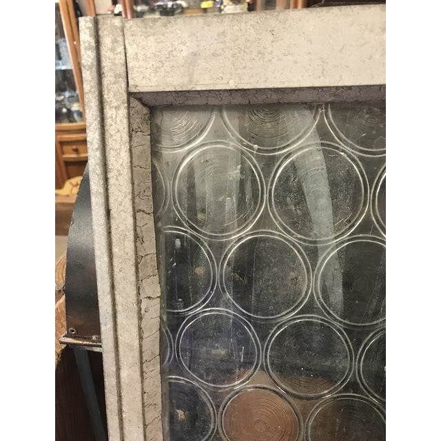 Beautiful glass bottle window . The frame looks like matted steel. , I have also seen it listed as Rondel Glass or Crown...