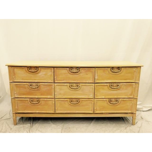 This stunning painted, bamboo style Mid-Century Modern dresser by Bassett Furniture company is perfect for storing...