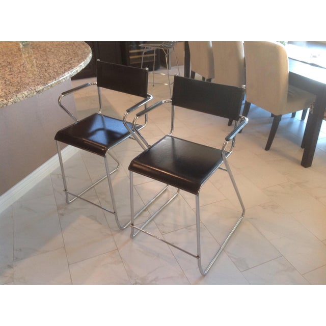 Vintage, original, mid century chrome and black leather counter height bar stool with arms. In the essence of Saarinen,...