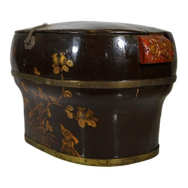 A beautifully hand-painted and lacquered 19th century Chinese wedding box with flowers showcasing an unusual round shape....