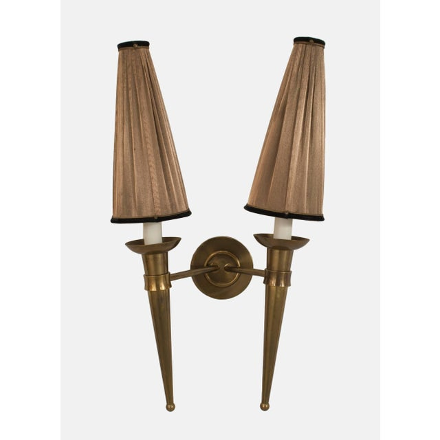 Pair of French, 1940s brass two torch form arm wall sconces with original brown upholstered conical form shades.