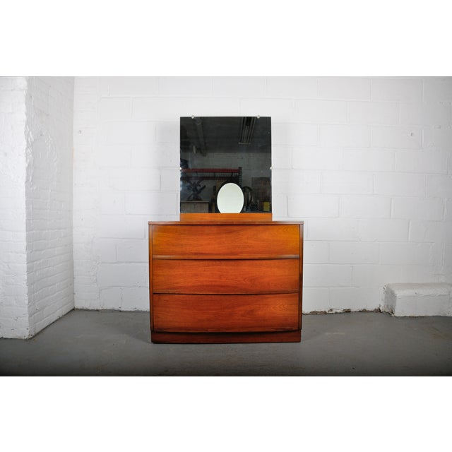 Mid-century modern vanity dresser made of walnut. The dresser features three spacious drawers and a mirror. Circa 1950. -...