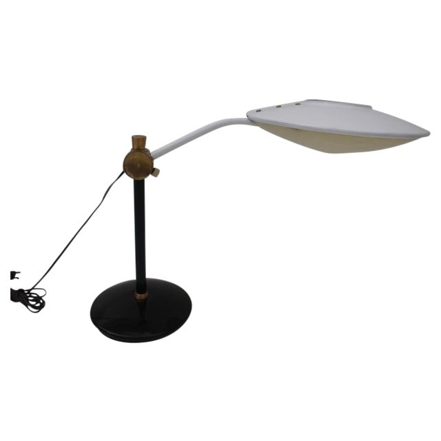 1970's Mid- century Dazor adjustable desk lamp with accent brass. Dimensions is : H 16 x W 14 X L 21.