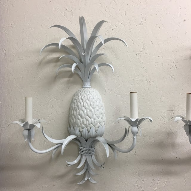 This is such a unique pair of vintage wall sconces. So Palm Beach chic! Wired and ready to hang.