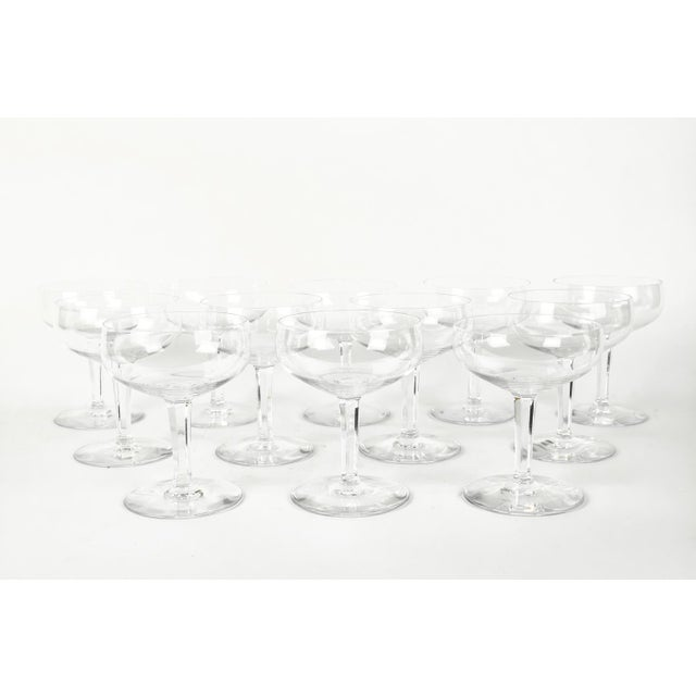 Set of 12 vintage French Baccarat crystal champagne coupes. All in excellent condition. Maker's mark on the bottom. Each...