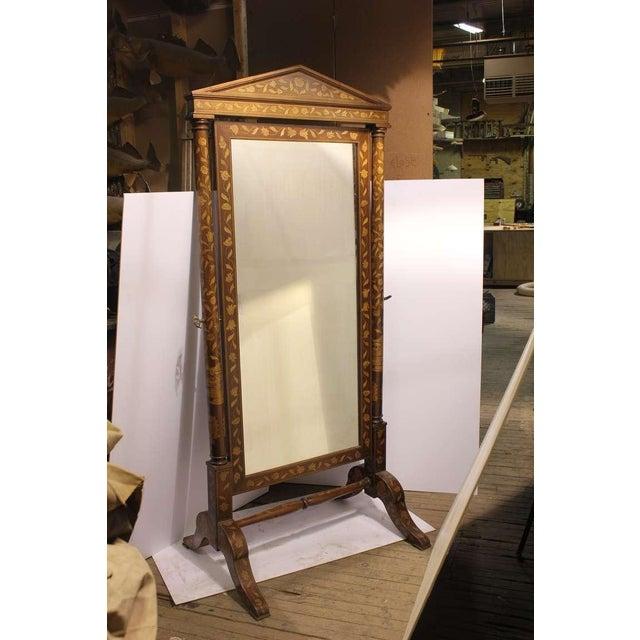 Elegant antique inlaid wood floor mirror.