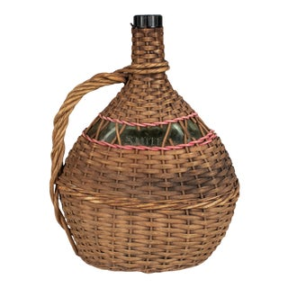 French Glass Bottle in Woven Basket For Sale