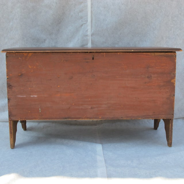 Early 19th-century original red painted blanket chest with queen ann cut outs on ends. Molded edge around the top. Inside...