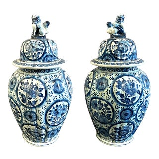Delft Blue & White Covered Urns Foo Dog Finials - a Pair For Sale