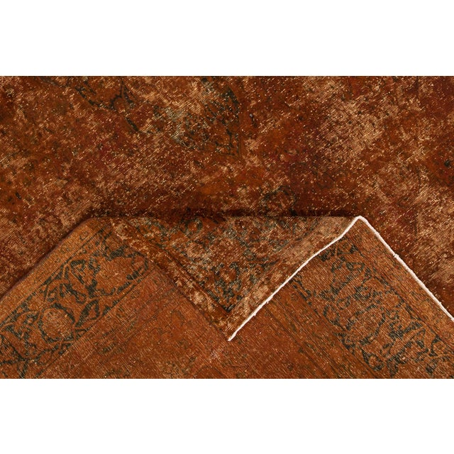 A hand-knotted vintage overdyed rug with a distressed medallion design. This piece has great detailing and colors. It...