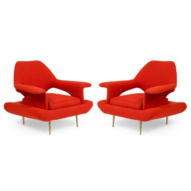 These 1960s large scale Italian lounge chairs feature tapered brass legs, comfortable paddle-style arm rests and original...