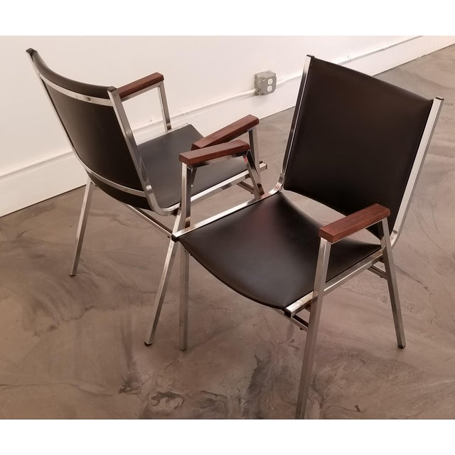 A pair of chrome steel and vinyl arm chairs by Cole Manufacturing. 1970's. Very good original condition.
