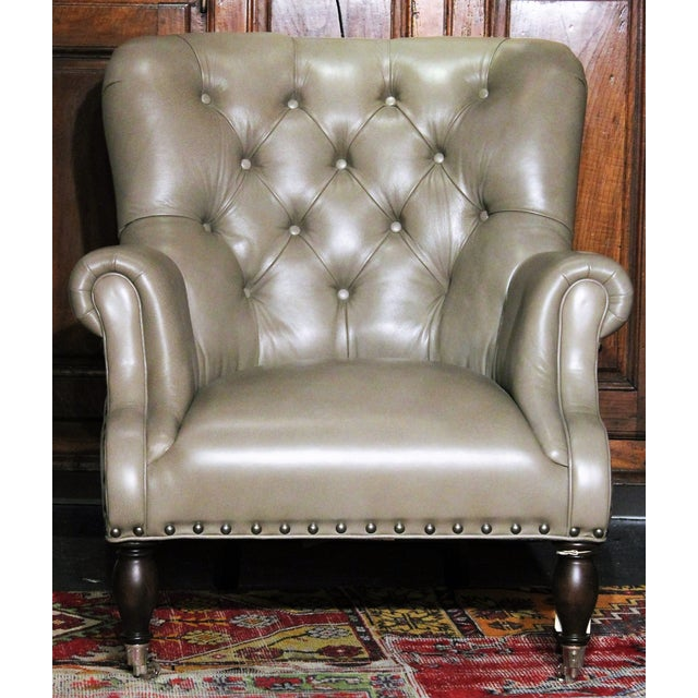 A beautiful, Logan chair by Vanguard with tight tufted back in pewter leather from The Tannery Co. Collection. This...