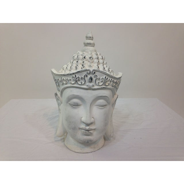 The large Buddha head will add interest and drama to your bookcase, tabletop or mantle. The head is made of plaster and is...