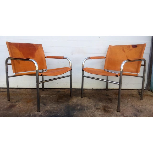 This listing is for a pair of vintage leather and Chrome Sling Chairs. Condition-excellent vintage condition with...