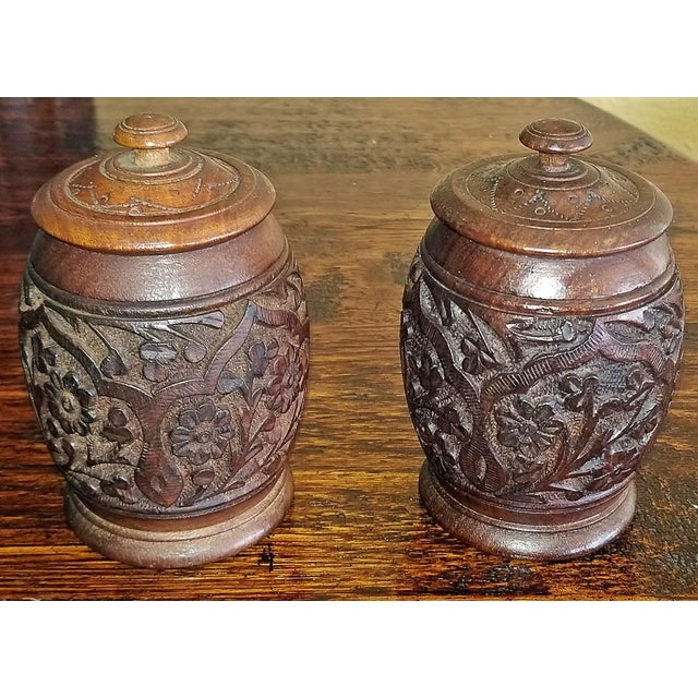 Nice pair of Anglo-Indian, hand-carved spice/tobacco jars. 19C Anglo Indian Pair of Carved Wooden Spice Urns. 19th...