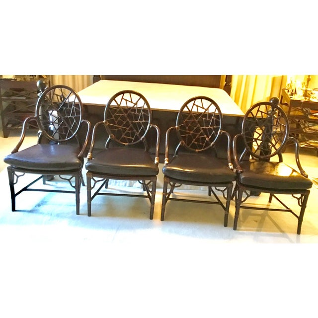 A set of 4 authentic McGuire Crackled Ice chairs with a Tobacco finish. The bamboo chairs are sturdy and lightweight, and...