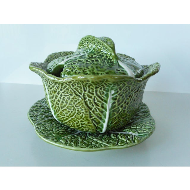 This lovely majolica green cabbage soup tureen set is a very detailed cabbage leaf pattern with white veins. The tureen...